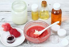 Making homemade lip gloss from various kinds of  oil and beeswax Stock Image