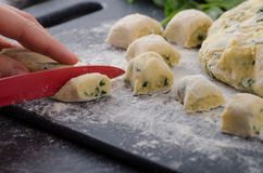 Making of homemade spinach gnocchi Royalty Free Stock Photos