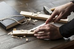 Making a homemade wooden cross on a table stock photos