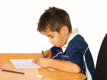 Making homework. A young boy working on his studies at home stock photography