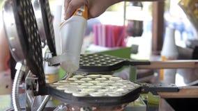 Making Hong Kong style egg waffle on street.