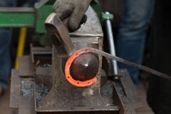 Making the horseshoe from heated rod Stock Images