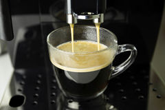 Making hot coffee on espresso machine Royalty Free Stock Images