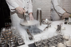 Making ice-cream with liquid nitrogen. Chef show Royalty Free Stock Photography
