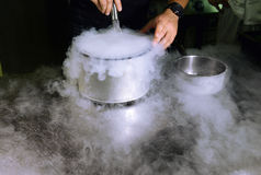 Making ice cream with liquid nitrogen. Professional cooking Stock Photos
