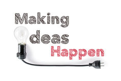Making ideas happen phrase and light bulb, hand writing, action Royalty Free Stock Photography