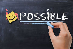Making the impossible possible concept on blackboard background Stock Photos