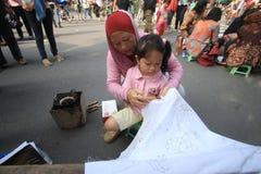 Making Indonesian traditional Batik Tulis Royalty Free Stock Photography