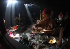 Making indonesian traditional chicken soup. Old women making indonesian traditional chicken soup in Solo, Central Java, Indonesia Stock Photography