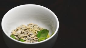 Making a pesto with basil, sunflower seeds and olive oil stock video