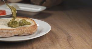 Making italian sandwich with speck and mozzarella apply pesto Royalty Free Stock Image