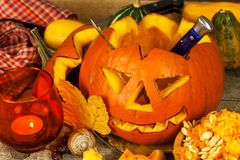 Making Jack o lantern. Carving the pumpkin. Hollowing out a scary pumpkin to prepare halloween lantern. Royalty Free Stock Photography