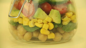 Making A Jar Of Salad stock video footage
