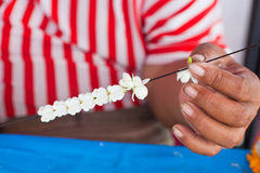 Making jasmine garland. That called Malaiin Thai Stock Photos