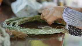 Making jewelery from natural materials stock footage