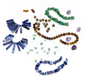Making Jewelry. Beads for making jewelry on a white background royalty free stock image