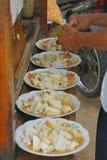 Making a ketoprak rice cake. royalty free stock photography