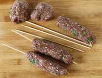 Making kofta skewers high angle Royalty Free Stock Image