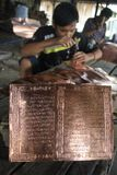 Making koran (Quran) from brass Stock Photography