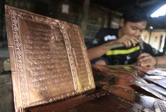 Making koran (Quran) from brass Stock Photography