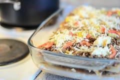 Making lasagna. Woman cooks lasagna in the kitchen Royalty Free Stock Photos