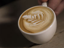 Making latte Art on a Cappucinno Stock Photo