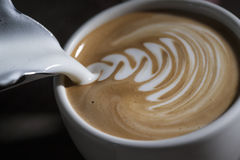 Making latte Art on a Cappucinno Stock Images