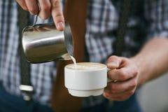 Making latte Stock Photos
