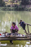 Making the laundry. Women are making the laundry at the bank of the river in Loikaw, Myanmar Stock Images