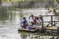 Making the laundry. Women are making the laundry at the bank of the river in Loikaw, Myanmar Royalty Free Stock Photos