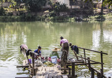Making the laundry. Women are making the laundry at the bank of the river in Loikaw, Myanmar Stock Photos
