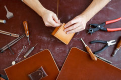 Making leather purse Stock Photos