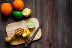 Making lemonade. Cookware and fruits on wooden table background top view copyspace Stock Photography