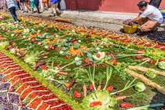 Making Lent carpet of vegetables, Antigua, Guatemala. Antigua, Guatemala -  March 26, 2017: Locals make procession carpet of vegetables during Lent in colonial Royalty Free Stock Images