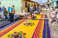 Making Lent carpets, Antigua, Guatemala. Antigua, Guatemala - March 26, 2017: Locals make dyed sawdust Lent procession carpets in colonial town with most famous stock photos