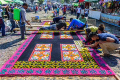 Making Lent carpets, Antigua, Guatemala. Antigua, Guatemala -  March 6, 2016: Locals make dyed sawdust Lent carpets with stencils for procession in colonial town Royalty Free Stock Photos
