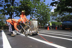 Making Line Way To Organize Line Traffic. Workers made a traffic line to regulate the flow in Surakarta, Java, Indonesia. Making its own line of traffic directed Stock Image