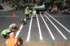 Making Line Way To Organize Line Traffic. Workers made a traffic line to regulate the flow in Surakarta, Java, Indonesia. Making its own line of traffic directed Stock Images
