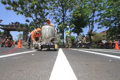 Making Line Way To Organize Line Traffic. Workers made a traffic line to regulate the flow in Surakarta, Java, Indonesia. Making its own line of traffic directed Royalty Free Stock Image