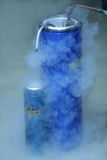 Making liquid oxygen. After inserting special tube into liquid nitrogen, you get puring oxygen out stock image