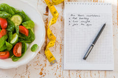 Making list of New Year`s resolutions. With healthy lifestyle Stock Photos