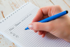 Making list of New Years`s resolutions Stock Photo