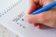 Making list of New Years`s resolutions Royalty Free Stock Photo