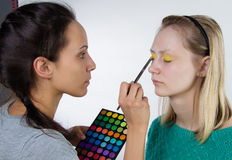 Making Make up with palette in hand Stock Photo