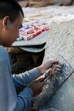 Making a Mani Stone. Nepal, Kathmandu, Buddhist Man Making a Mani Stone Stock Images