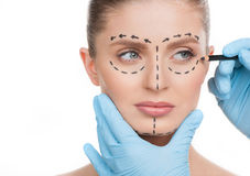 Making marks on face. Stock Photography