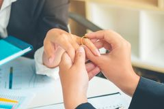 Making marriage proposal in office giving engagement ring to woman, Wedding concept stock photography