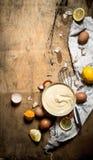 Making mayonnaise from eggs, garlic and lemon. Stock Photography