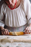 Making meat dumpling with wooden rolling pin. Stock Photography
