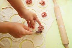 Making meat dumplings Royalty Free Stock Images